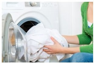 homeowner taking out laundry out of dryer