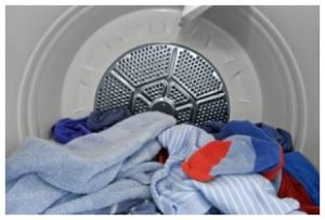 Clothes and towels in the dryer.