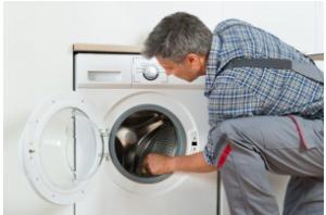 Repairman Checking Washing Machine At Home in sydney, nsw