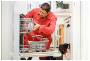 technician fixing a broken dishwasher in the kitchen